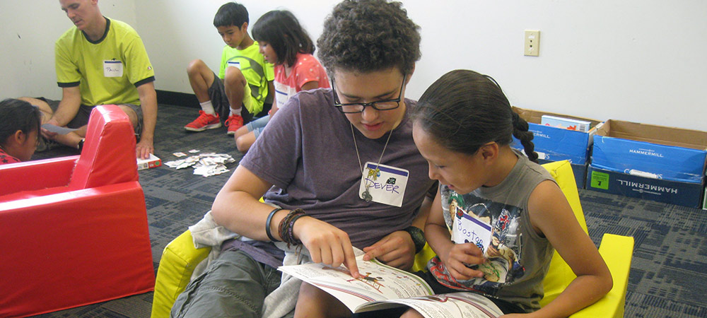 Reading to a camper